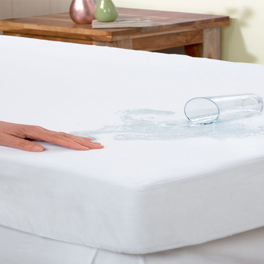 MATTRESS with a glass full of water splashed on it